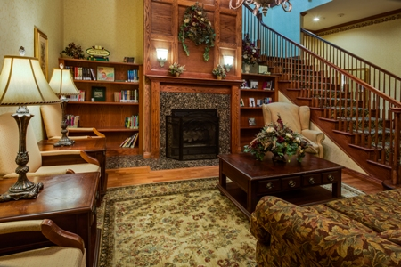 Bookshelf, fireplace and seating area of our Merrillville hotel