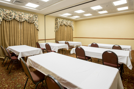 Merrillville meeting space with a classroom setup and white table linens