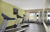Fitness center with two treadmills, a multi-gym and an elliptical