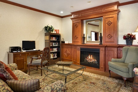 Hotel lobby with with a fireplace, library and business center