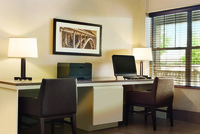 Business center with computer and printer for guest use