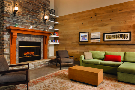 Lobby with comfortable seating, fireplace and lending library