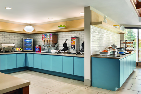 Breakfast bar featuring hot options, cold cereals and waffle makers