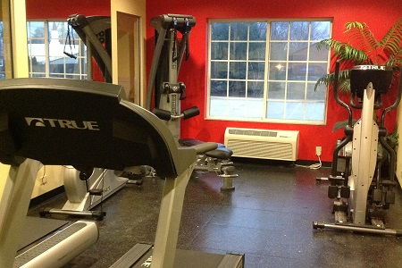 Valparaiso hotel fitness center with stationary bike and treadmill