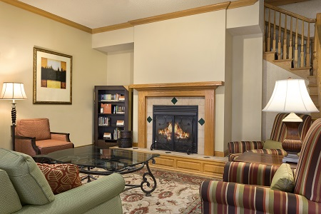Hotel lobby with a fireplace and bookshelves