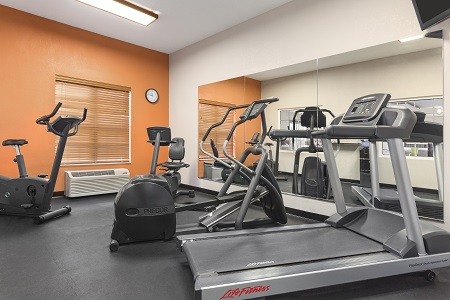 Salina hotel's fitness center with treadmill and other cardio equipment