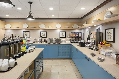 Complimentary breakfast bars with cereal, coffee, fruit and waffle maker