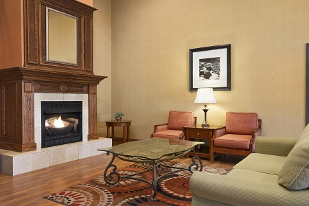 Hotel lobby with seating around the fireplace