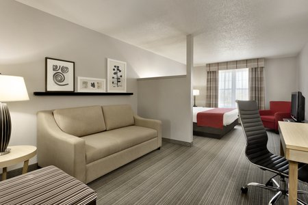 Sleeper sofa, work desk and king bed in Louisville