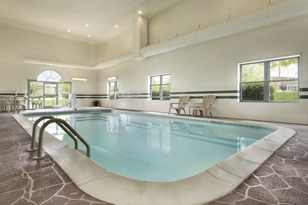 Heated indoor pool and lounge chairs