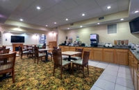 Tables and chairs in our Paducah hotel's breakfast room
