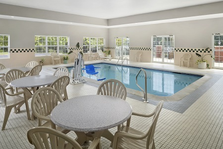 Heated indoor pool with tables and chairs