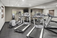 Fitness center with treadmills at Shepherdsville hotel