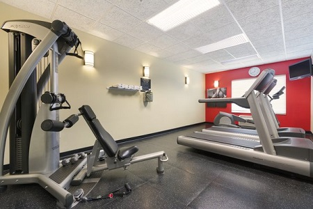 Hotel fitness center with treadmills and weight machine