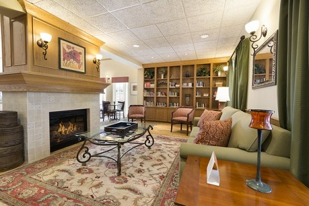 Spacious hotel lobby with fireplace and area rug