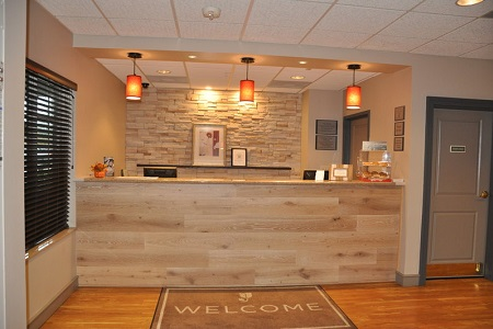 Welcoming reception desk with wooden accents and free cookies