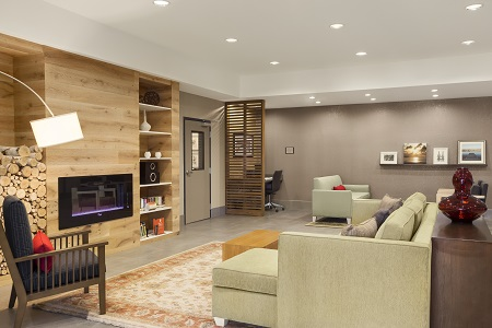 Contemporary lobby with a fireplace and comfortable seating