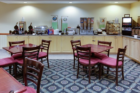 Breakfast items and seating in the dining area