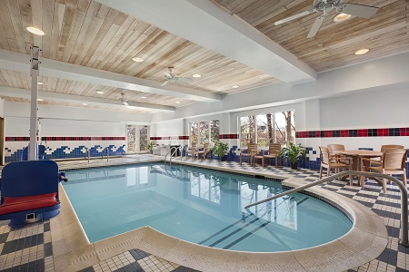 Hotel's indoor pool with seating