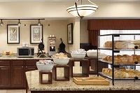 Hotel's free, hot breakfast with bagels, fruit and waffles