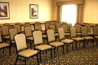 Meeting space with rows of chairs facing the front of the room