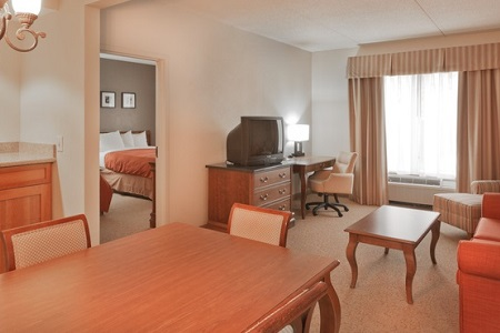 BWI airport hotel's suite featuring living and dining areas