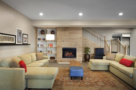 Welcoming lobby with a fireplace and two plush couches