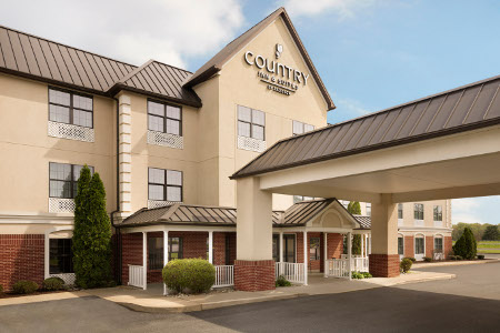 Country Inn & Suites, Salisbury, MD hotel exterior with a carport