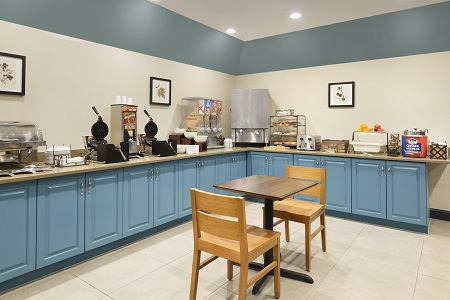 Breakfast items on blue cabinets in the dining area