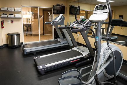Fitness center with treadmills and cardio equipment
