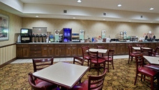 Hotel dining room with free hot breakfast in Big Rapids