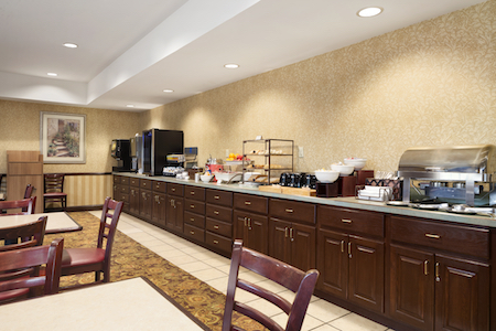 Hotel's breakfast bar with hot items, waffles and fruit