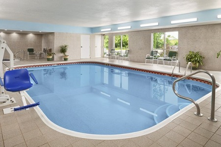 Indoor pool with a blue hydraulic chair