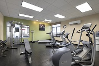 Hotel fitness center with elliptical and treadmills