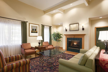 Spacious lobby with fireplace and seating in Kalamazoo