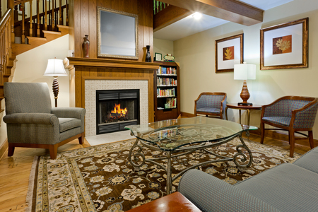 Couches and chairs surround the fireplace in our hotel lobby