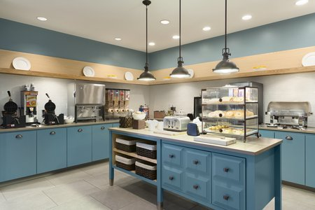 Light blue cabinets in our Marquette hotel's dining area