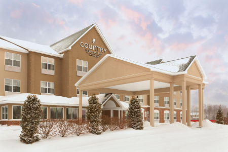 Country Inn & Suites hotel exterior covered with snow