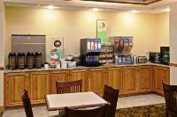 Dining area's breakfast bar with coffee, cereal and juice
