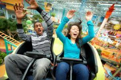 Couple riding the indoor roller coaster at the Mall of America