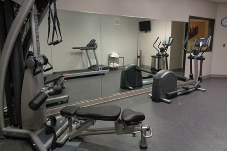 Fitness center with a treadmill, elliptical and multi-functional weights machine
