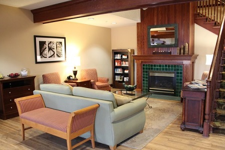 Hotel lobby in Brooklyn Center, MN includes fireplace and sofa