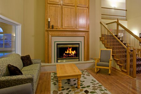 Lobby with comfortable seating and a fireplace