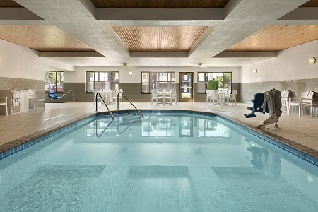 Sparkling indoor pool at our modern St. Cloud hotel