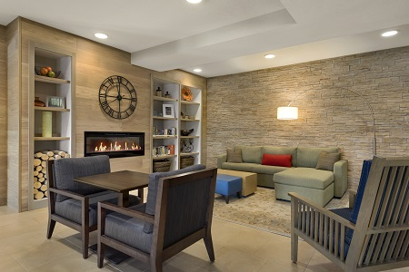 Couch set against a stone accent wall in our fireplace-lit lobby