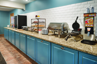 Breakfast area with waffle makers, hot options and more