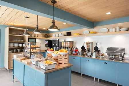 Hotel breakfast room with bright blue cabinetry