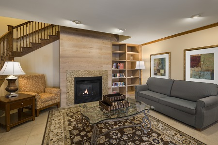 Spacious lobby with fireplace and seating in Owatonna