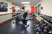 Hotel's fitness center with free weights and a stationary bike