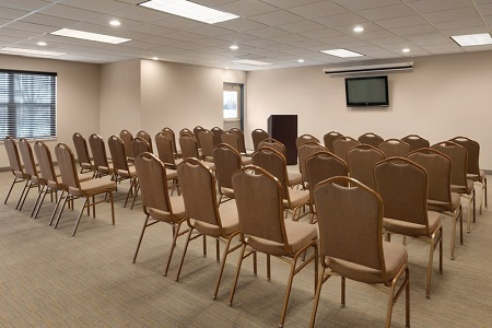 Hotel event space with chairs arranged theater style